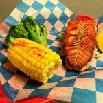 Knoxville seafood lunch grilled salmon with broccoli and corn